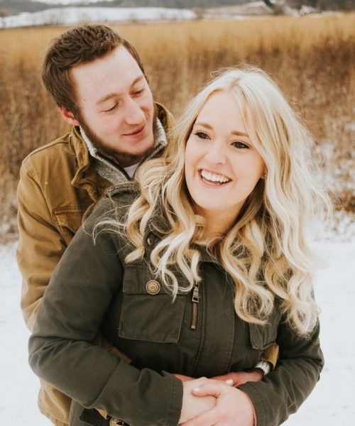 winter snowy engagement photo